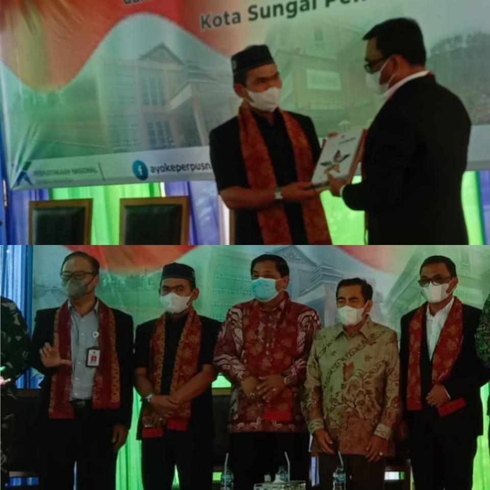 Ketua DPRD Sungai Penuh H.Fajran saat menghadiri acara peresmian gedung perpusatakaan.
